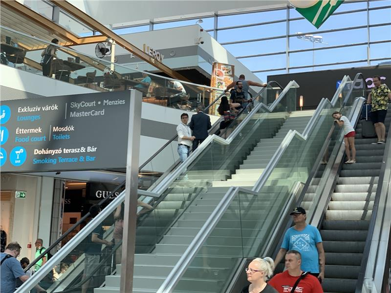 Escalator to airport lounges at Budapest Terminal 2