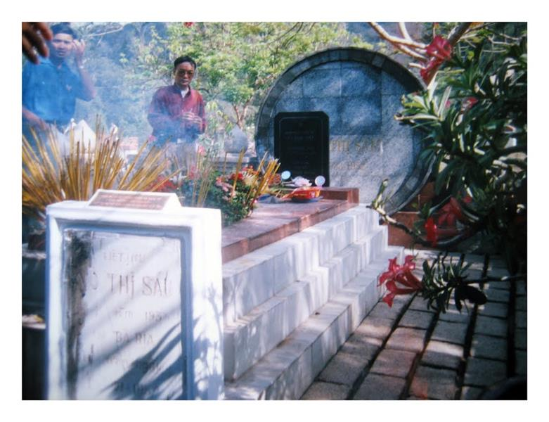 Incensing before Vo Thi Sau Tomb
