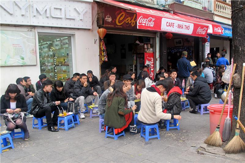Drink coffee with plastic chairs in Hanoi