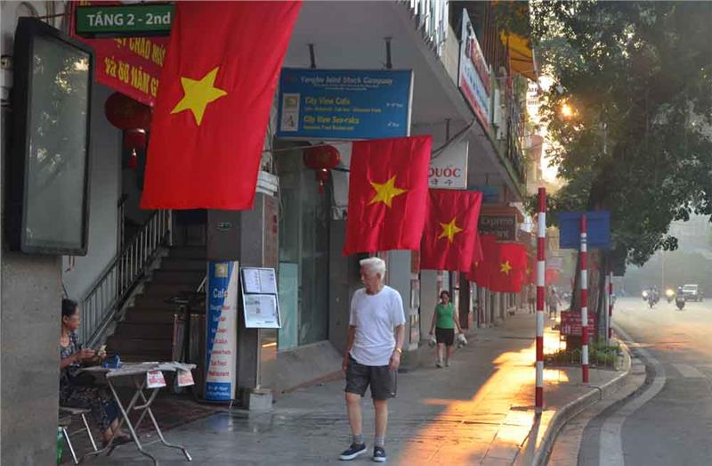 National flags hung in 60th Anniversary of Hanoi Liberation Day