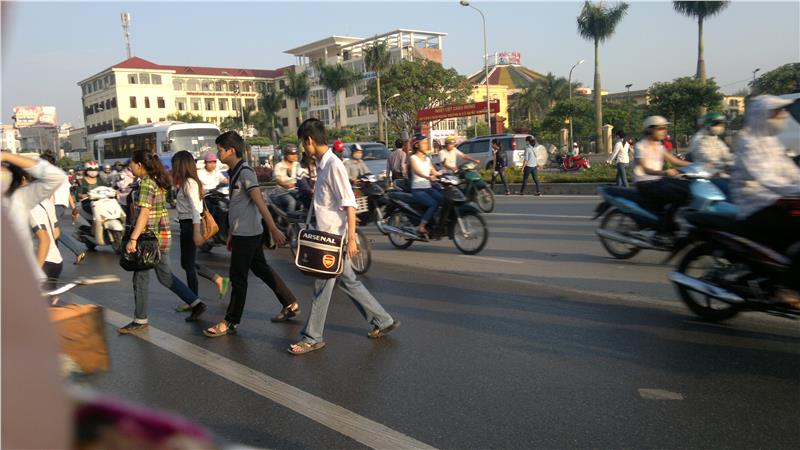 Students are crossing a street in Vietnam