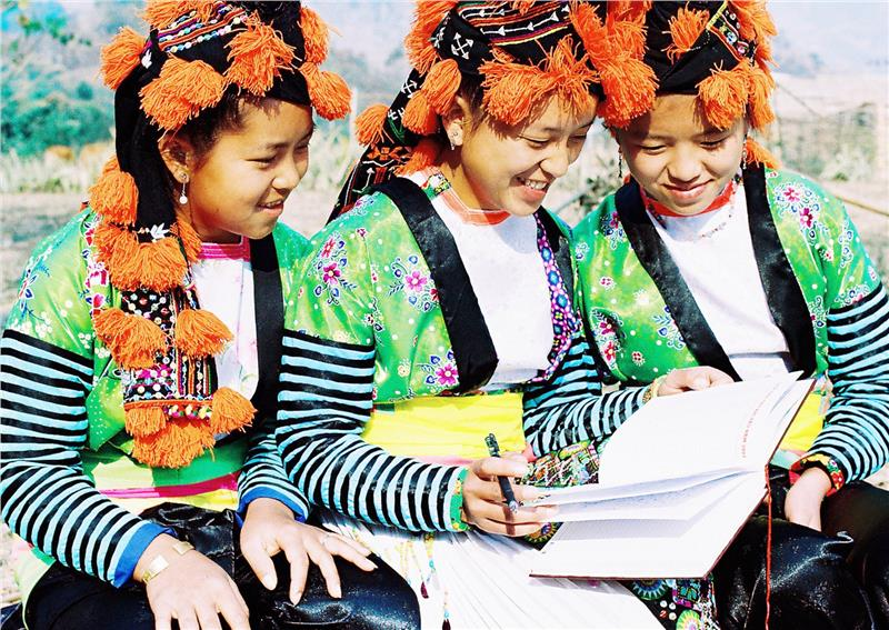 Hmong girls in traditional costumes