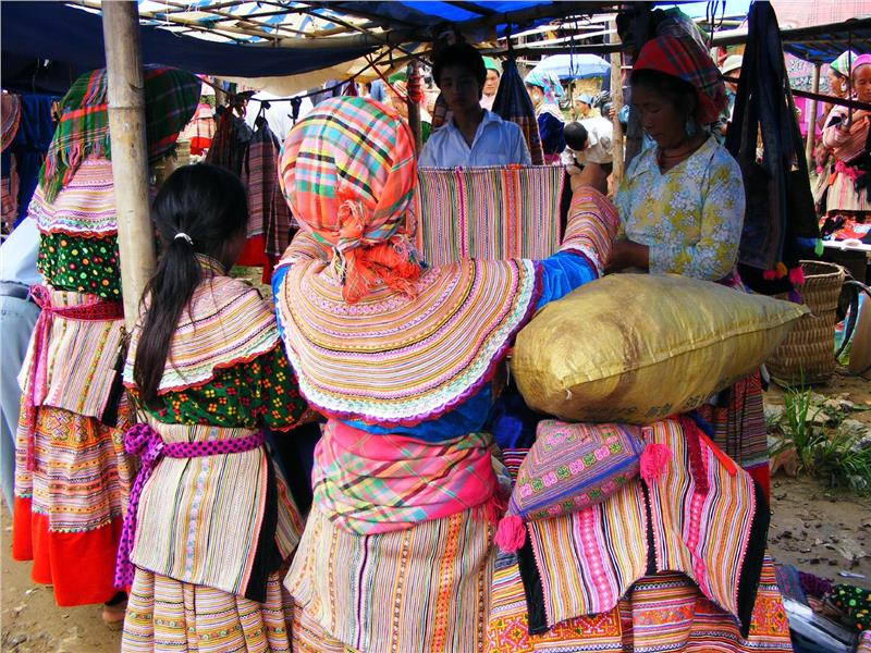 Local Bac Ha villagers shopping for more colorful clothing