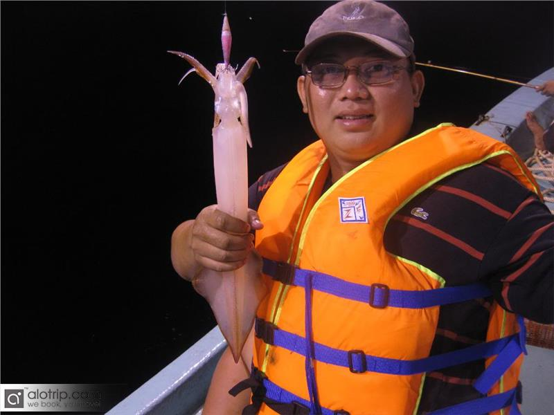 Fishing squid at Cua Lo beach