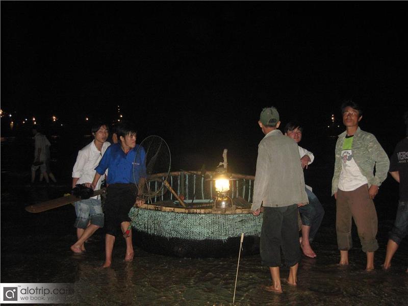 Fishing squid at Cua Lo beach
