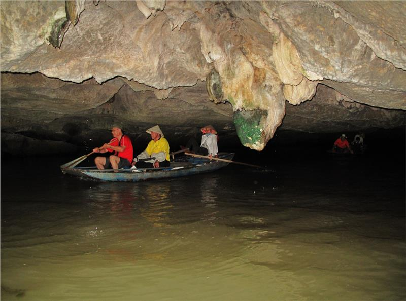 Traversing a cave in Trang An