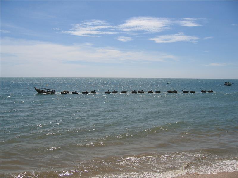 String of fishing boats at Rang Beach