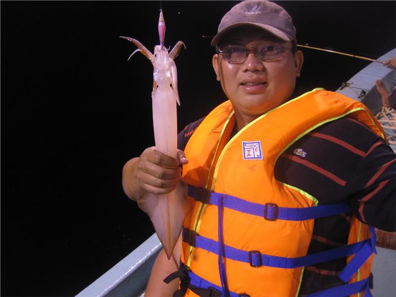 Tourist at squid fishing trips Phu Quoc