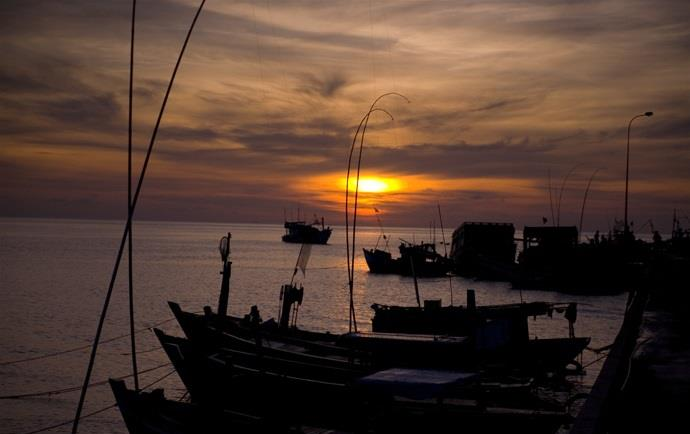Peaceful sunset in Ham Ninh Pier