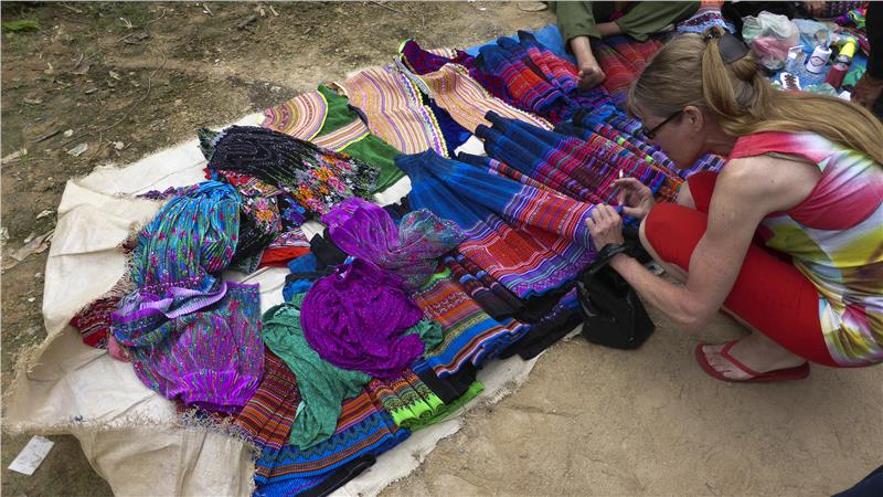 Flower Hmong clothing for sale in Bac Ha Market