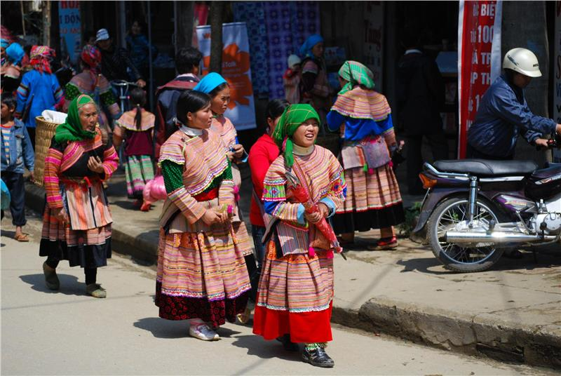 Flower Hmong girls in sneakers at Bac Ha Market