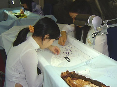 The girls works in XQ embroidery village