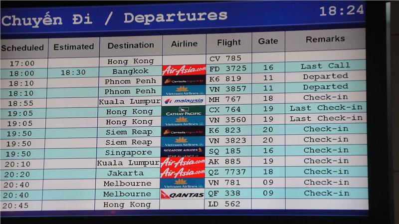 Screen showing departures at Tan Son Nhat International Airport