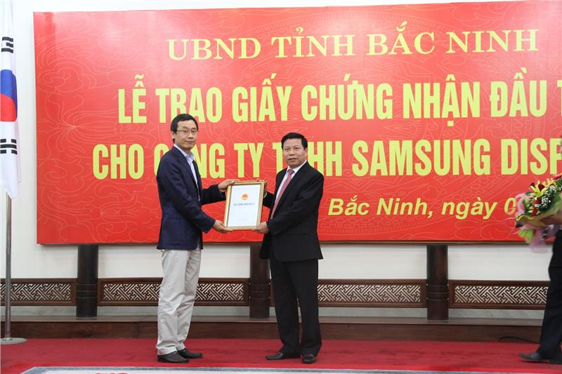 Ceremony of handing license for Samsung Display