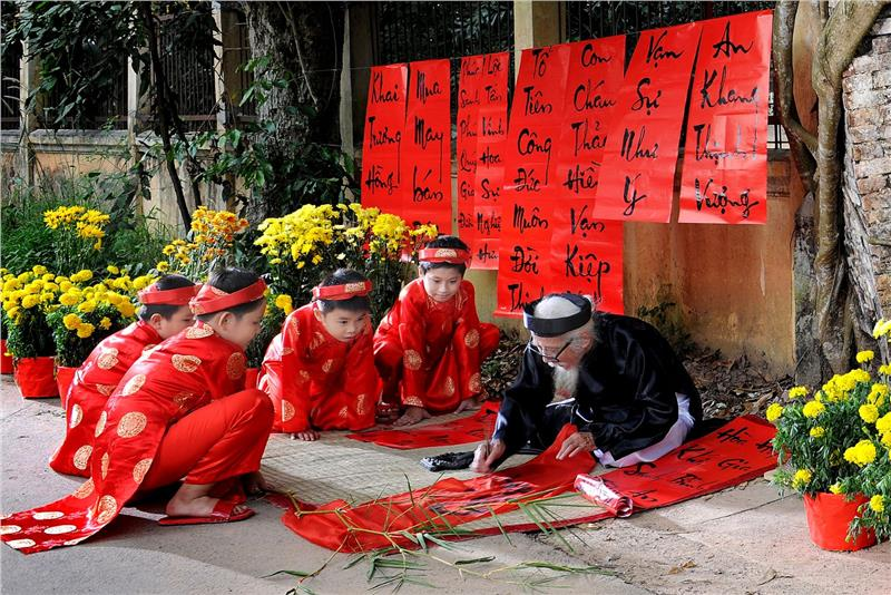 A calligraphist writes Nom characters in Tet Vietnam