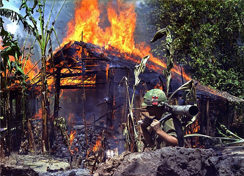 A Viet Cong base camp is torched by US troop
