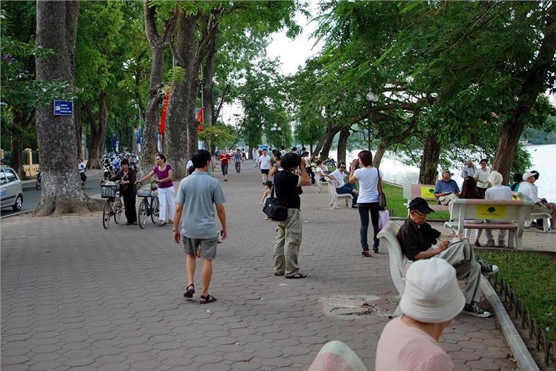 People do morning exercise around Hoan Kiem Lake