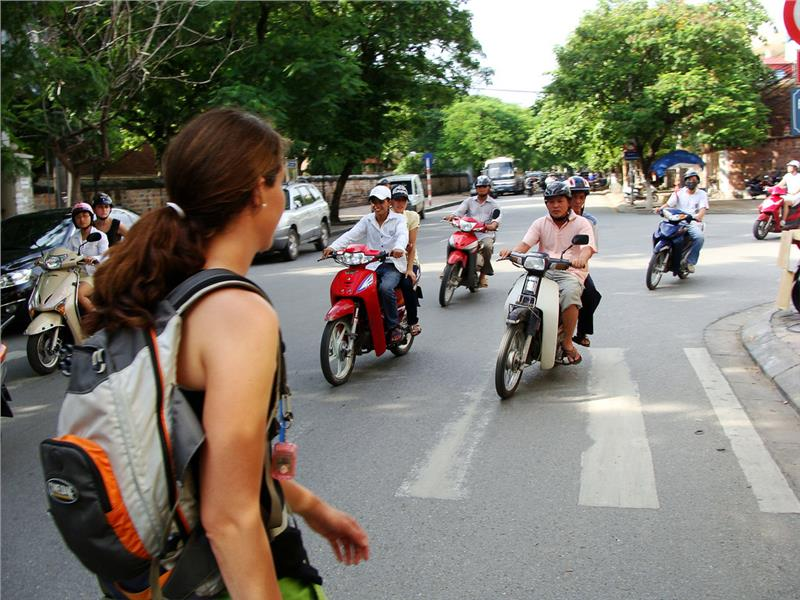 A brave pedestrian crossing Vietnam road